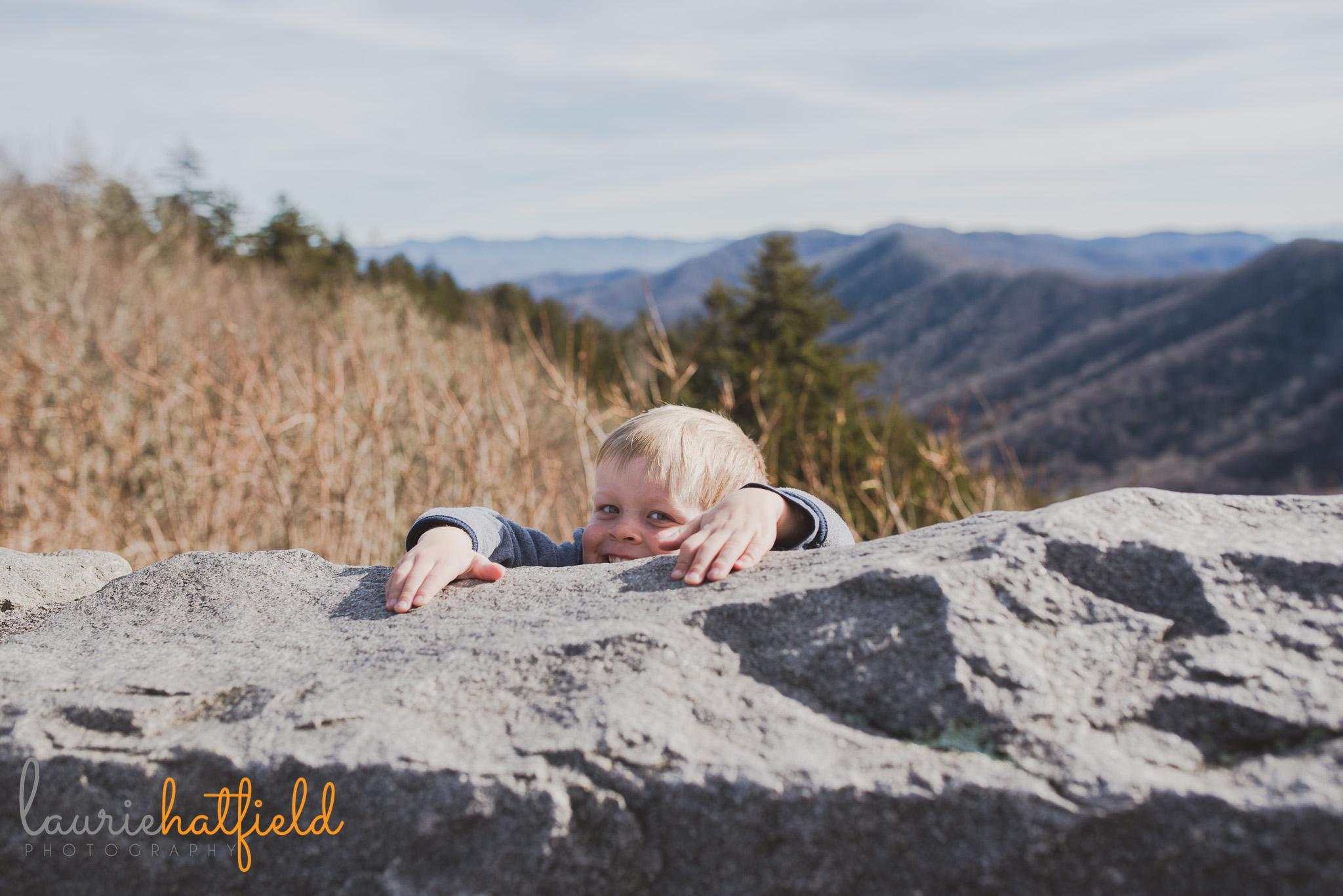 little boy holding onto rock | Mobile AL family photographer