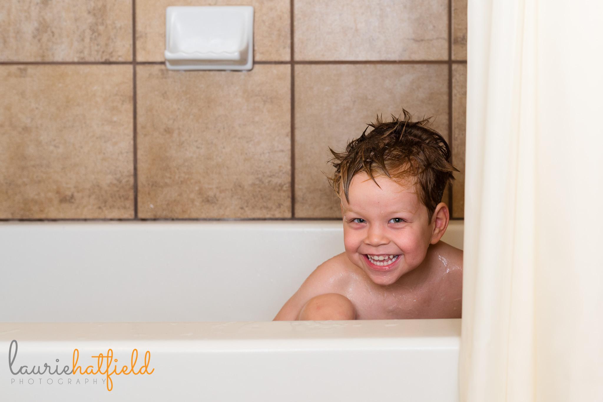 little boy playing in bathtub | Fairhope AL family photographer