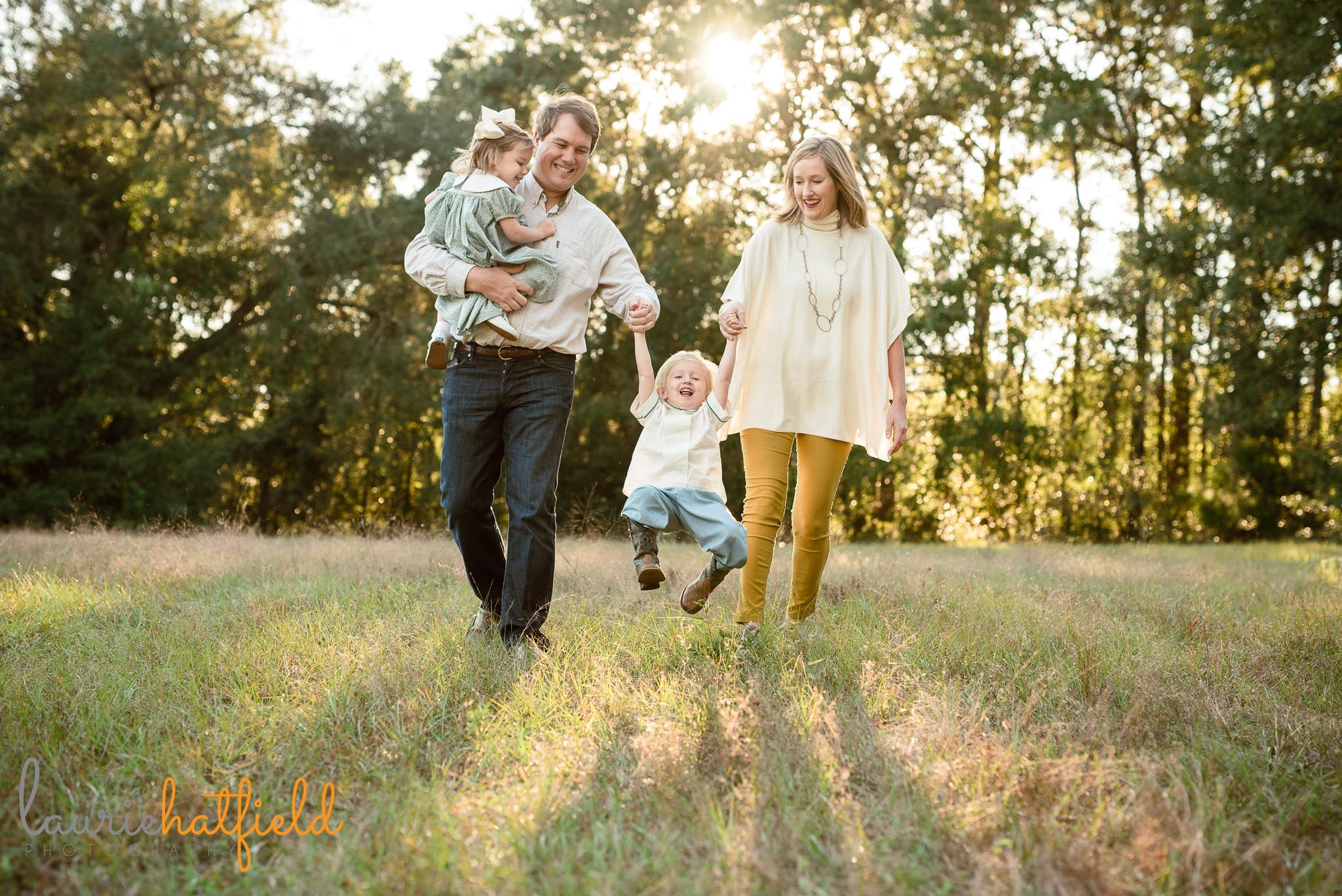 family of four in field | Saraland AL lifestyle photographer