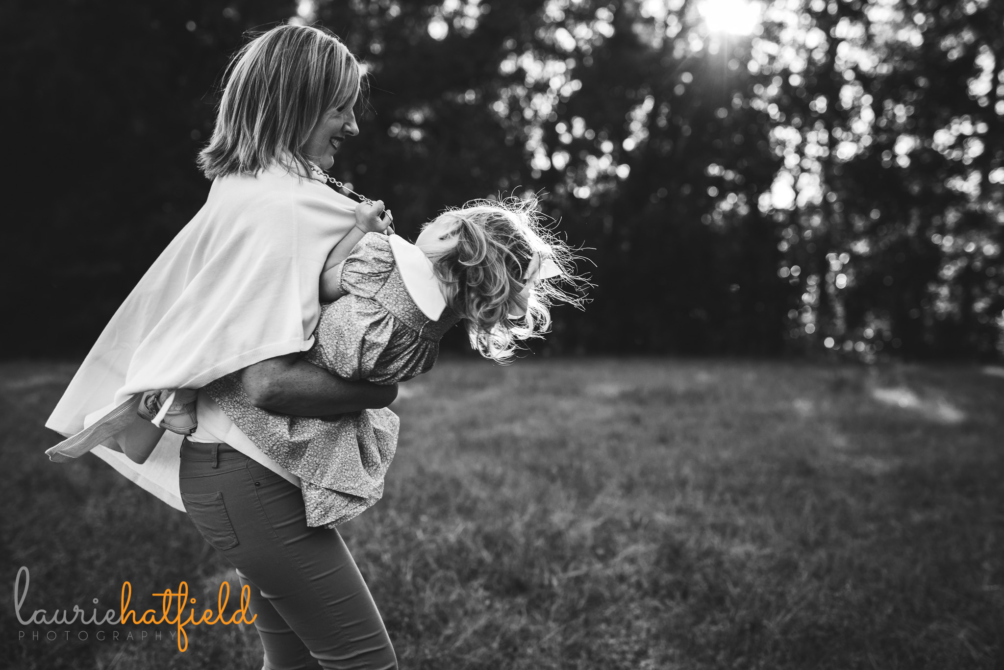 mom twirling with little girl | Pensacola FL family photographer