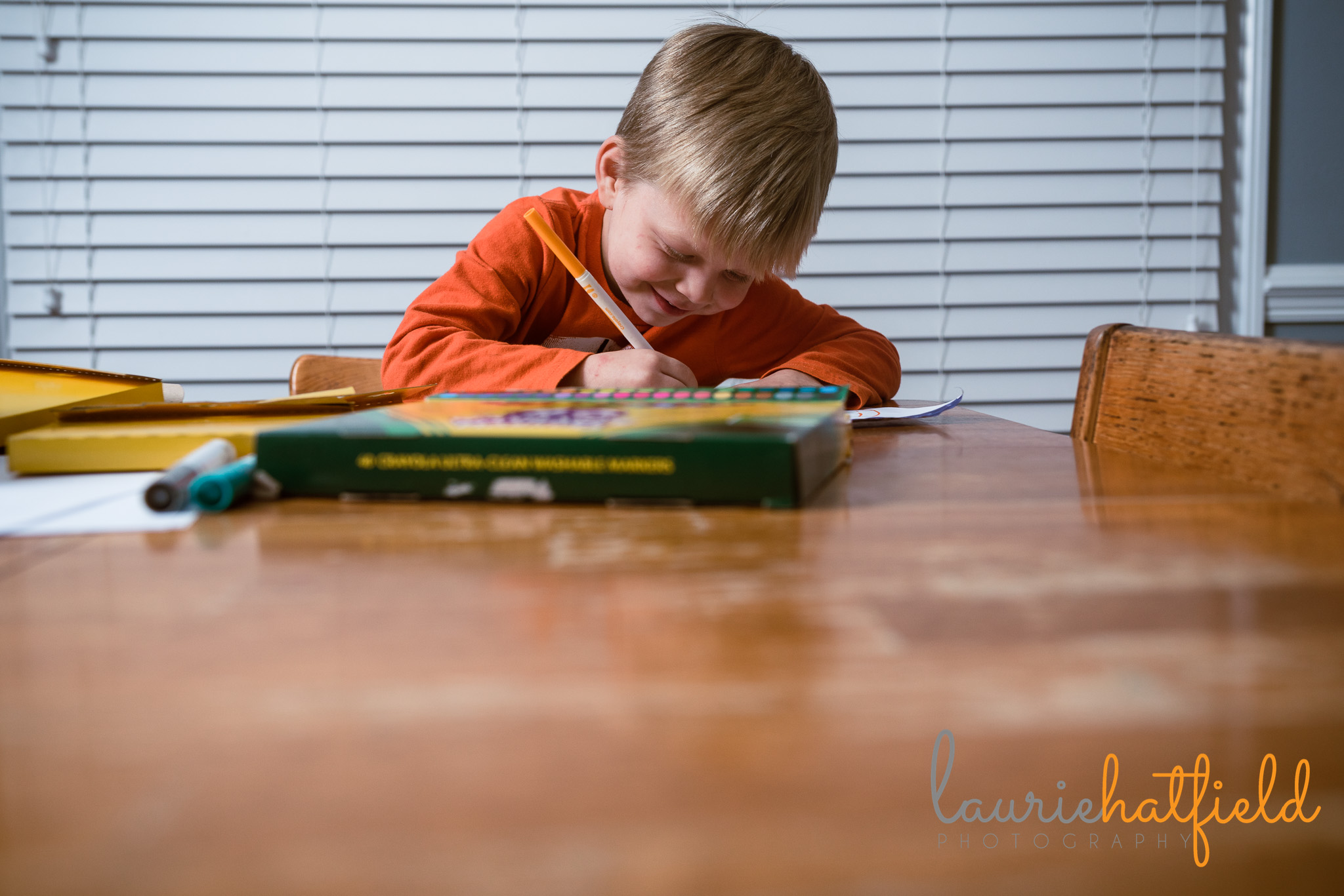 4-year-old boy coloring with markers | Pensacola FL family photographer