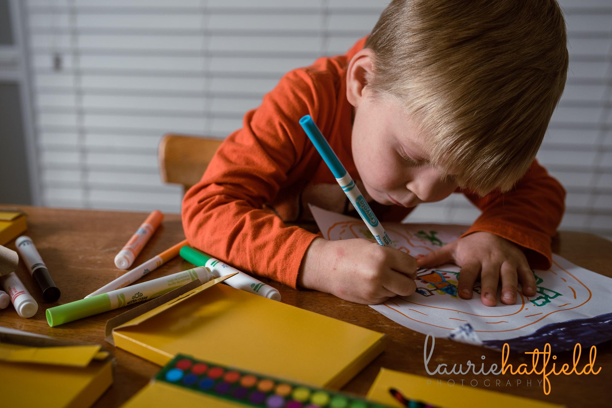 4-year-old boy and artwork | Saraland AL family photographer