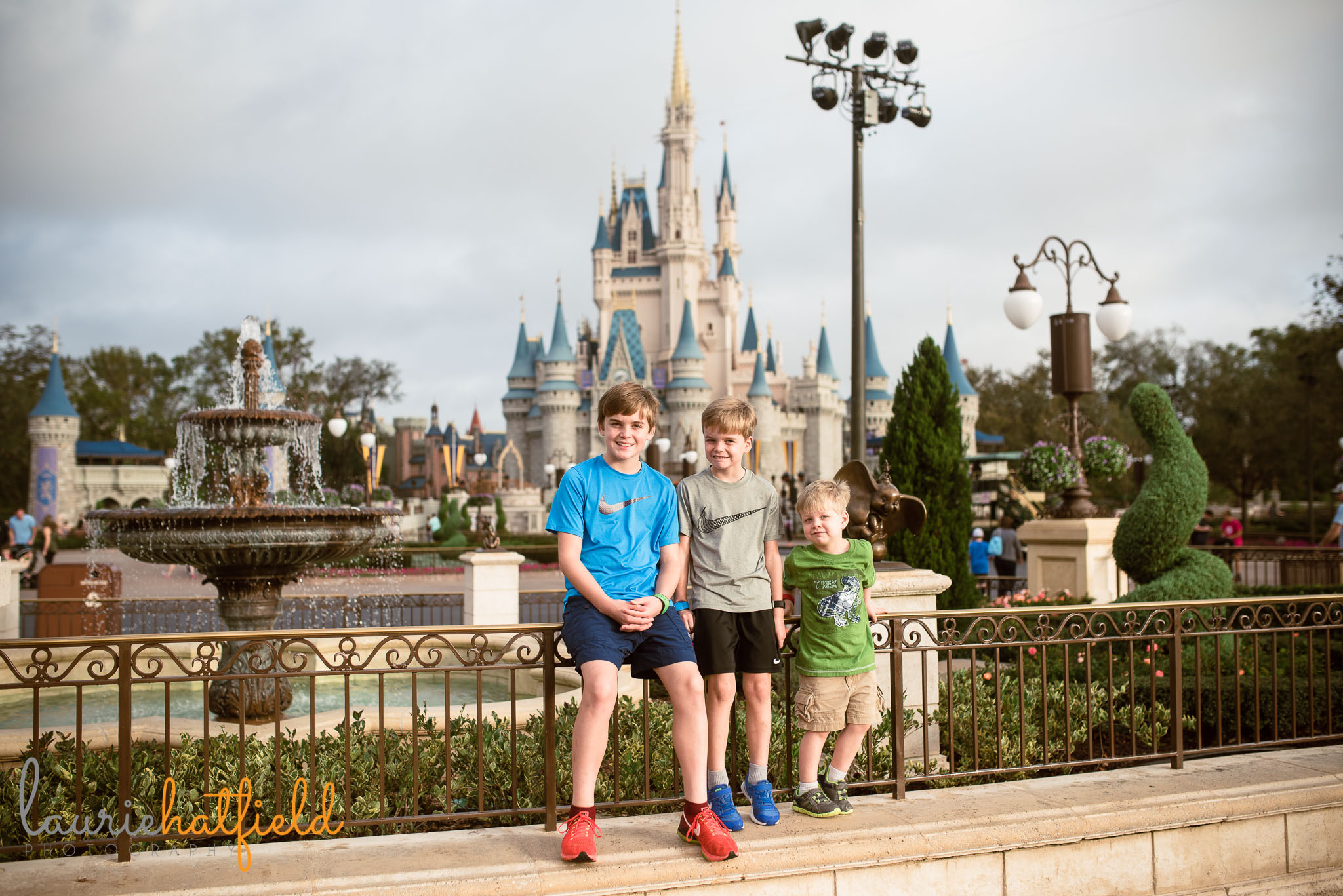 3 brothers in front of castle at Disney World | Fairhope AL family photographer