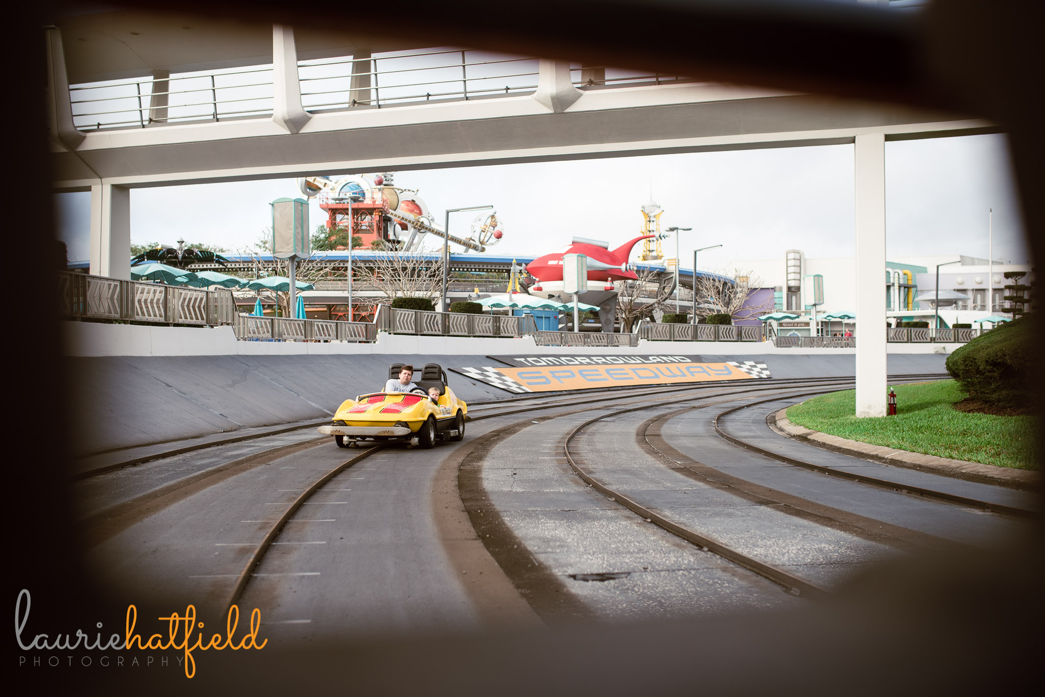 dad and son on Tomorrowland Speedway | Mobile AL family photographer
