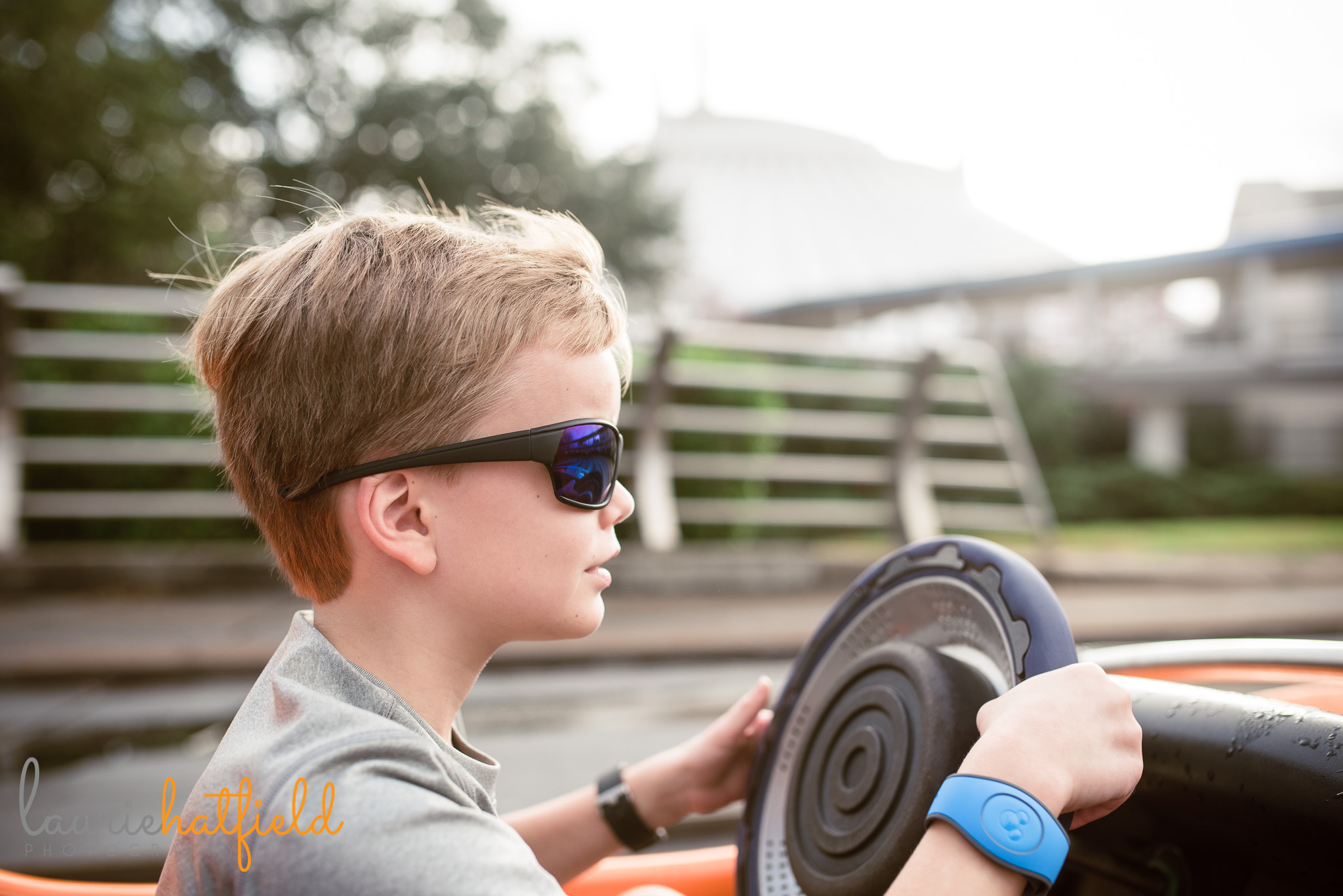 8-year-old driving at Tomorrowland Speedway | Mobile AL family photographer