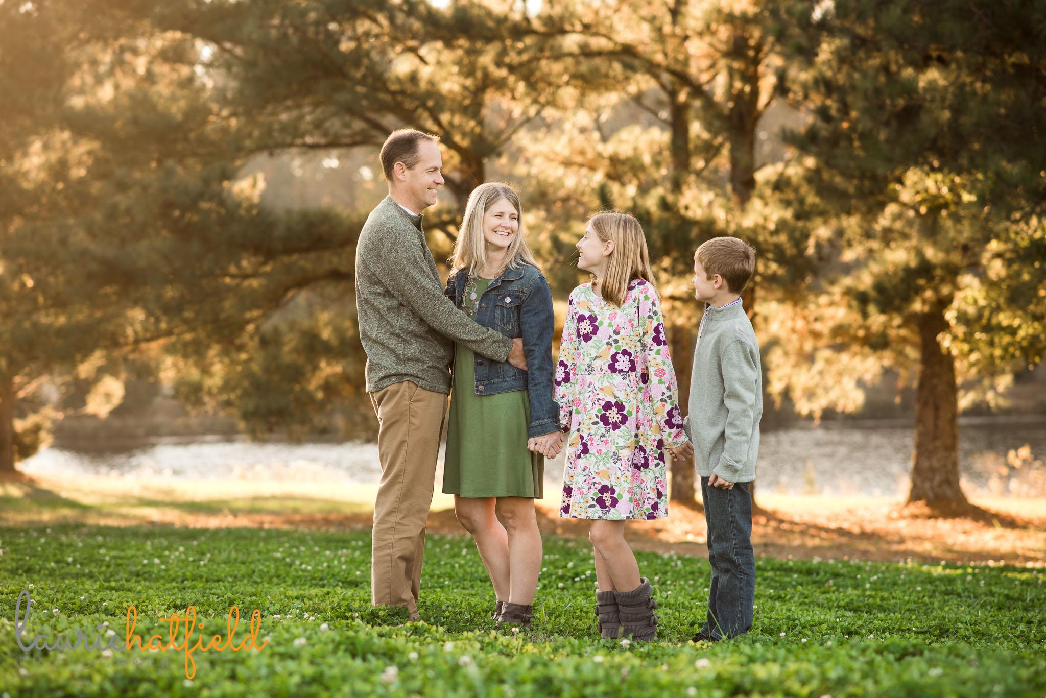 family of four in field | Fairhope Al photographer