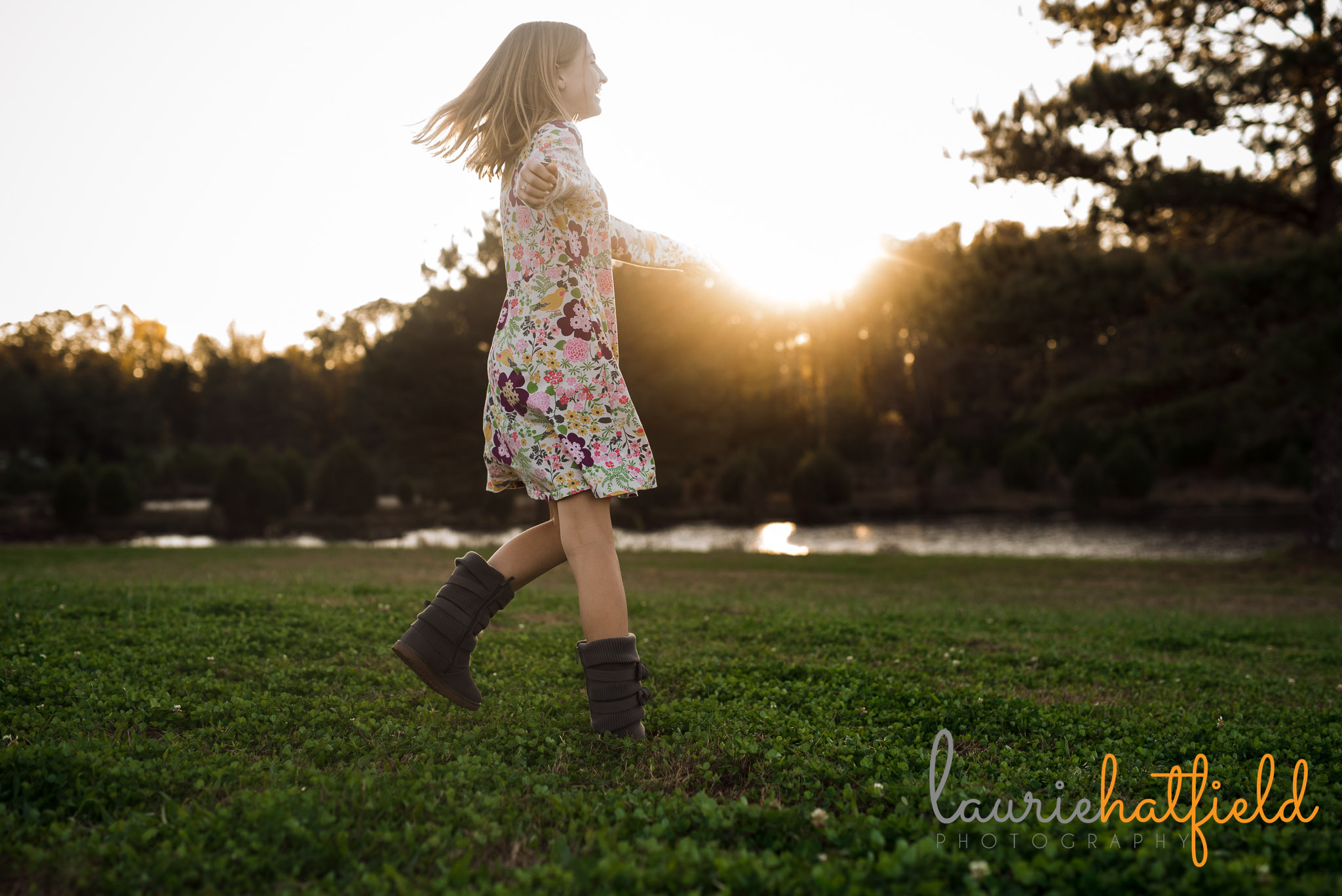 girl twirling in field | Mobile AL family photographer