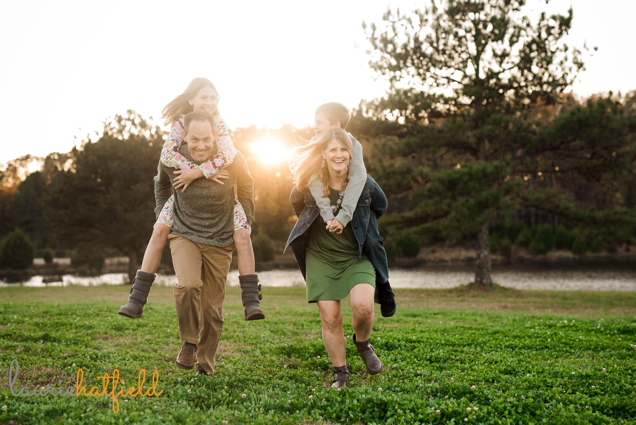 family of four giving a piggyback ride | Mobile AL lifestyle photographer