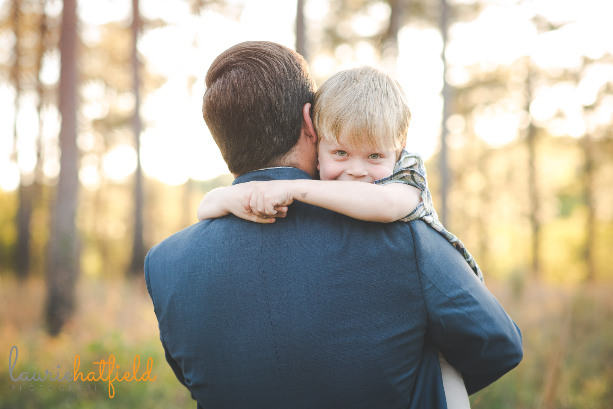little boy in dad's arms | Mobile AL family photographer