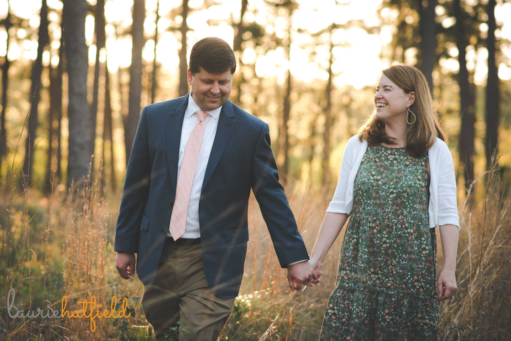 couple holding hands in field | Mobile AL engagement photographer