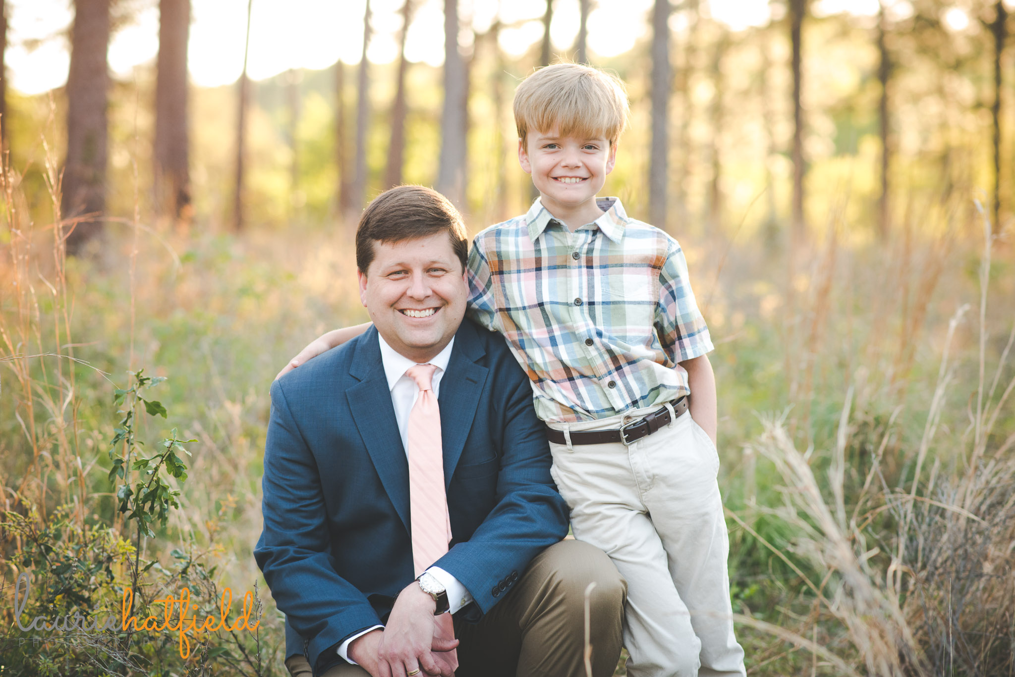 dad with 8-year-old son in field | Mobile AL family photographer