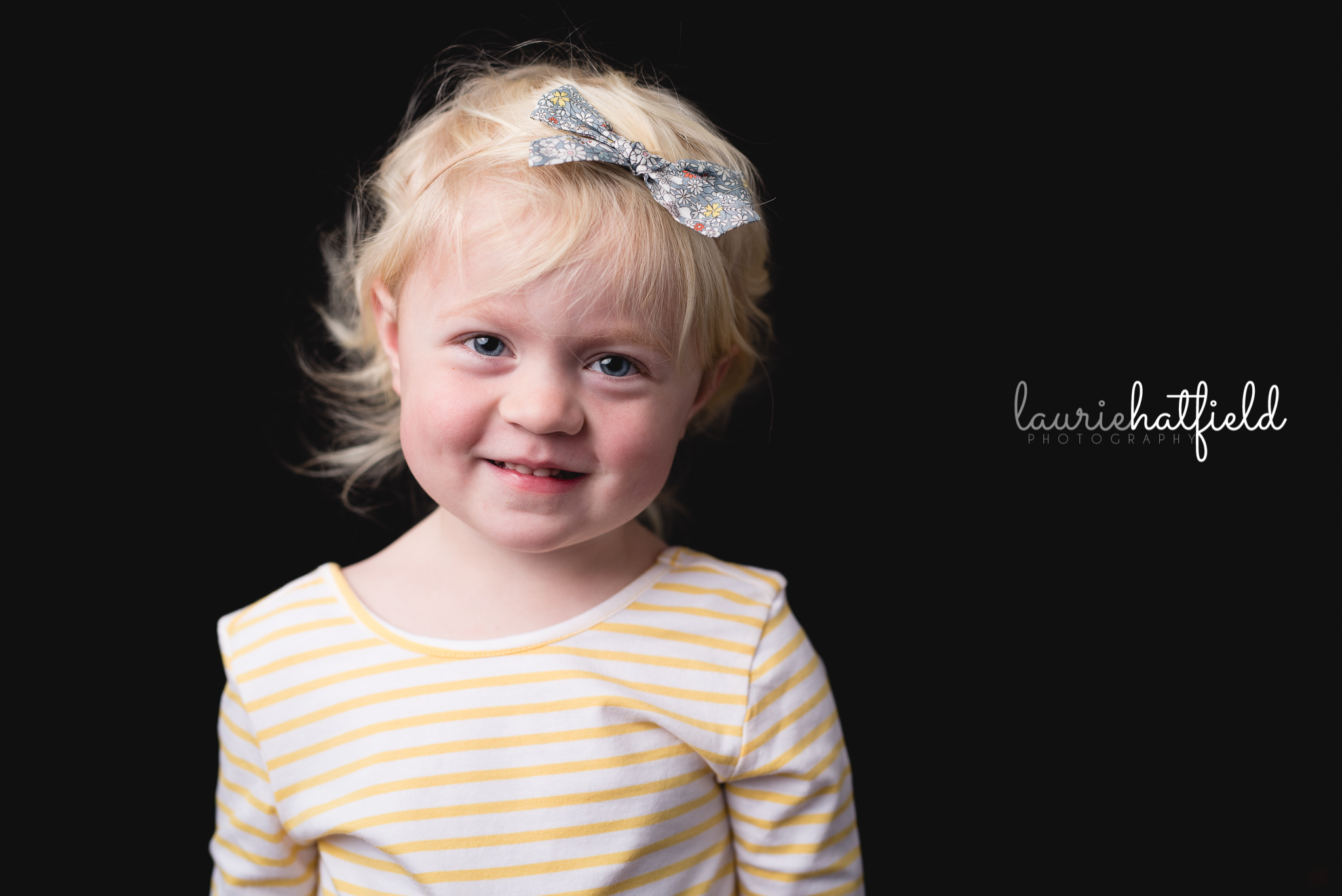 blonde girl with yellow bow   Mobile AL school photographer
