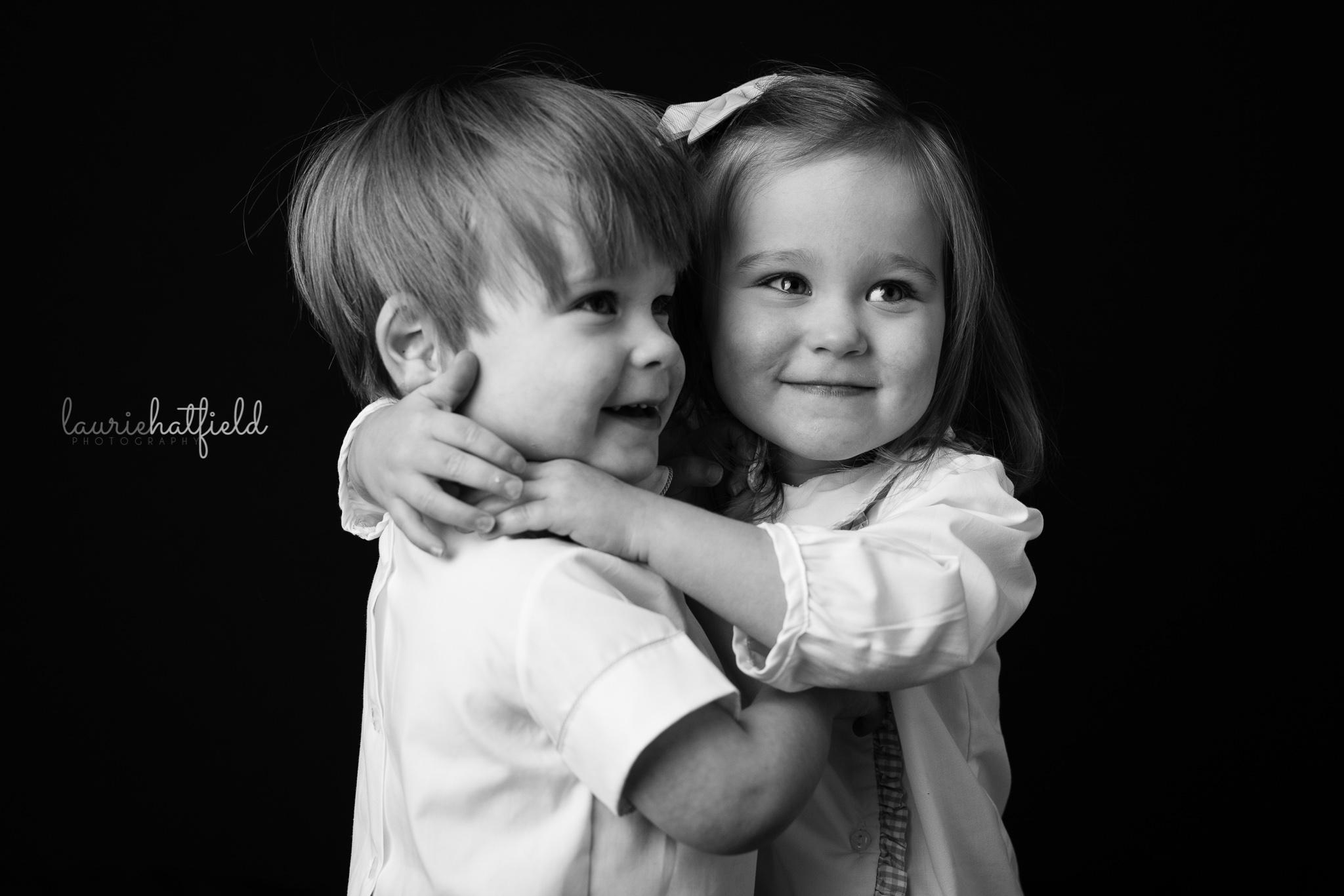twin boy and girl hugging   Mobile AL preschool photographer