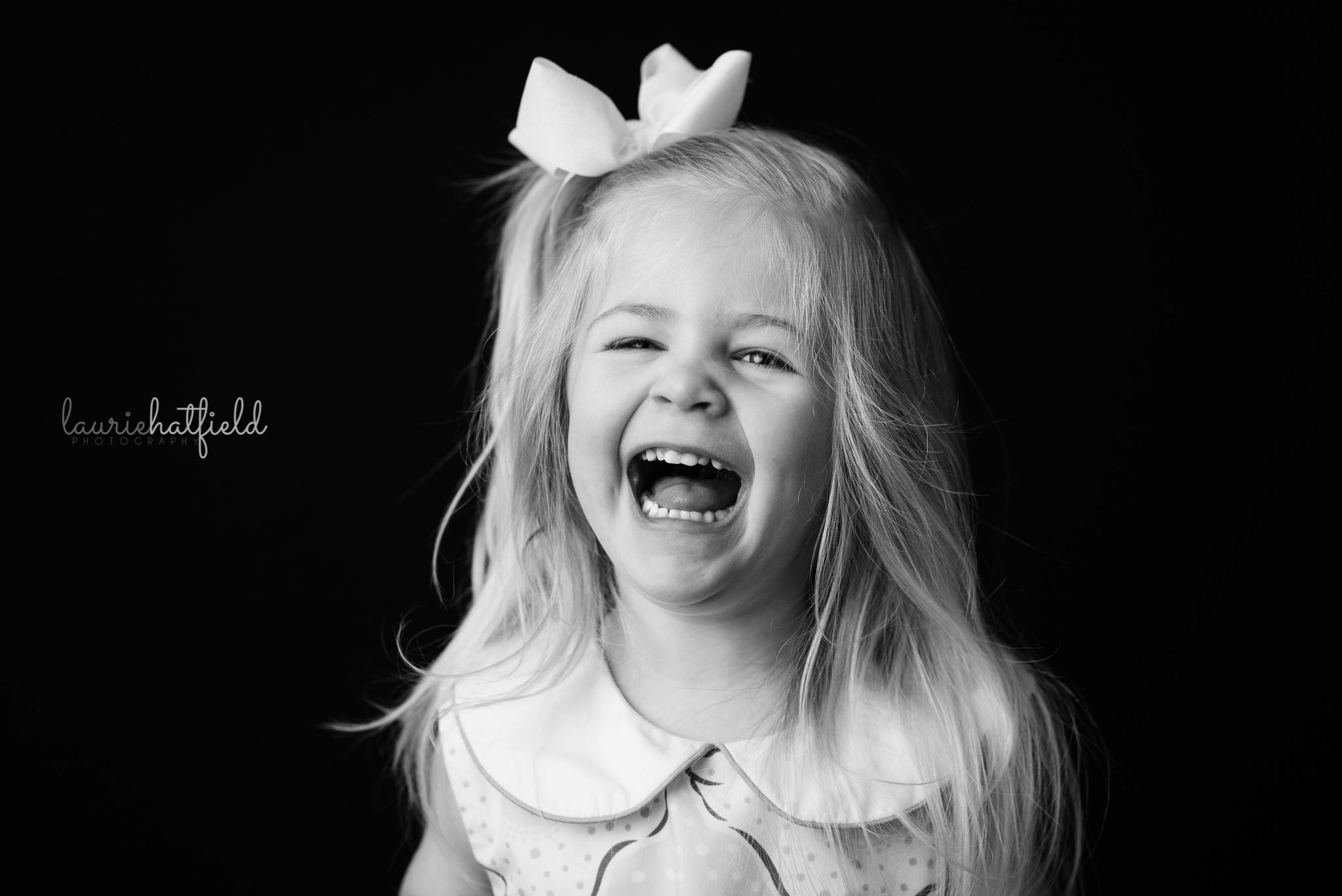 little girl laughing   Mobile AL school photographer