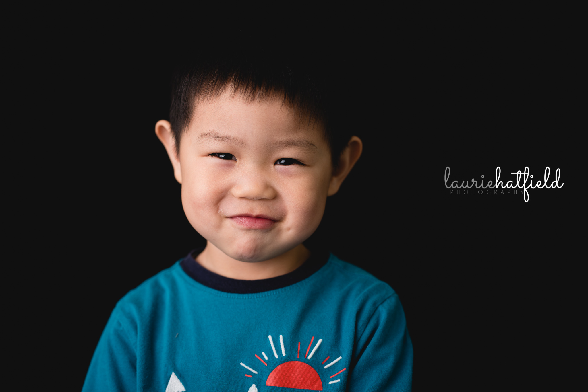 Asian boy in blue shirt   Mobile AL preschool photography