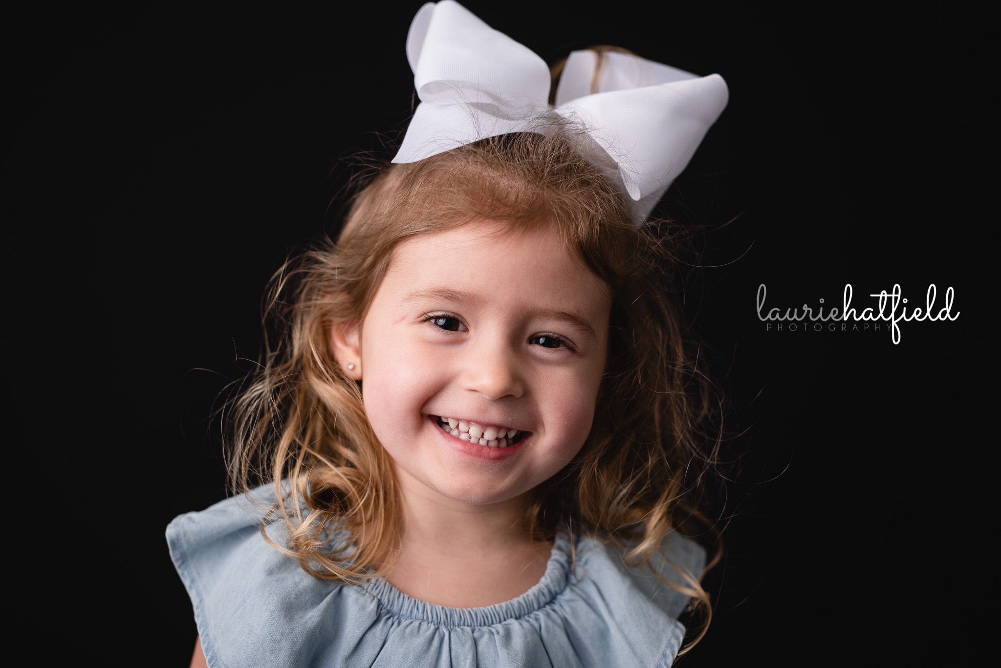 little girl with white bow   Gulf Shores AL school photographer