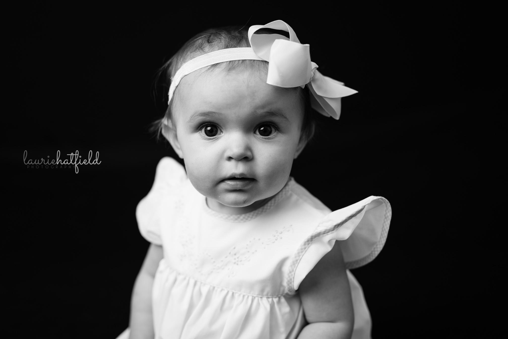 baby with white bow   Mobile AL fine art school portraits
