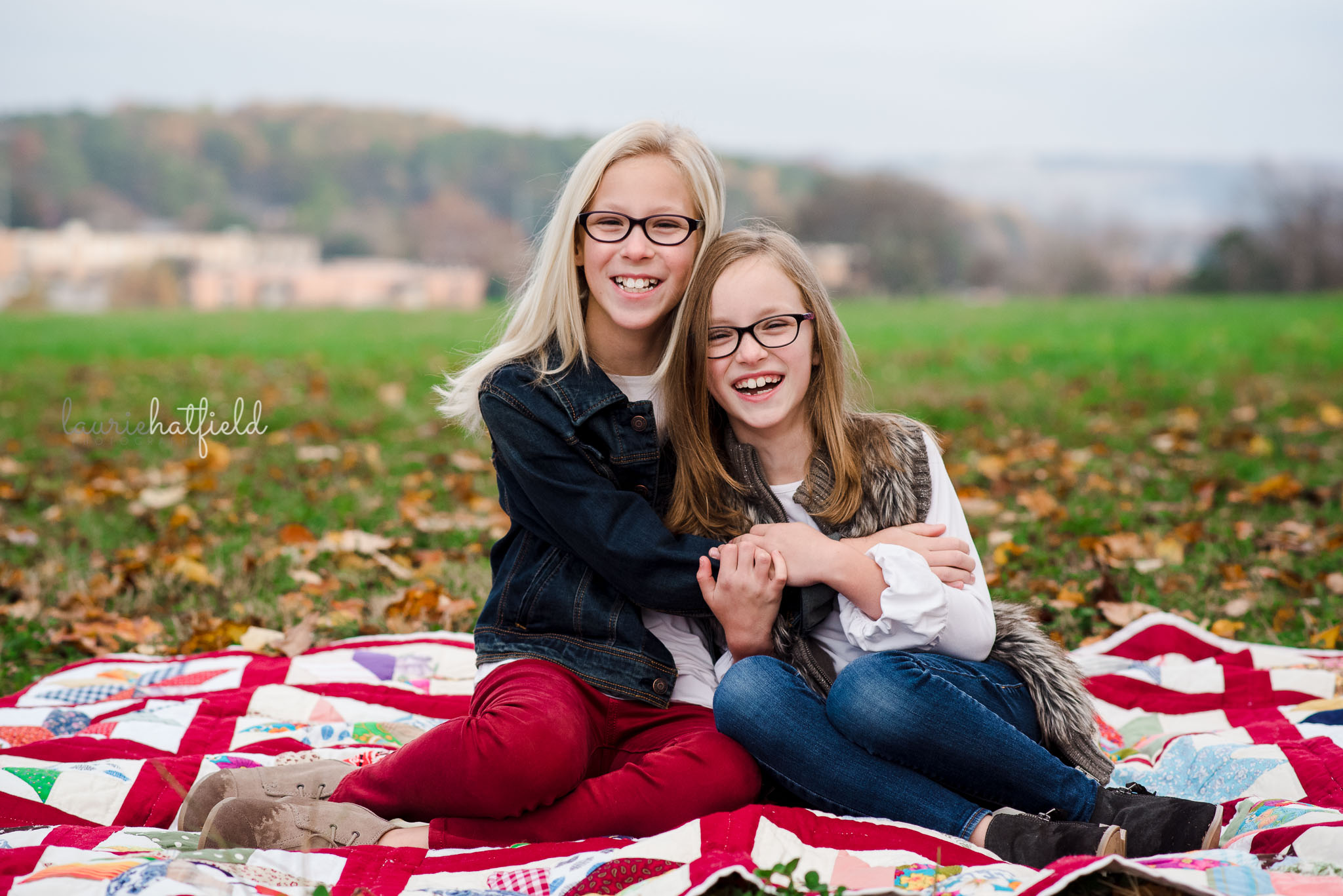 sisters sitting on a blanket | Gulf Shores AL family photographer