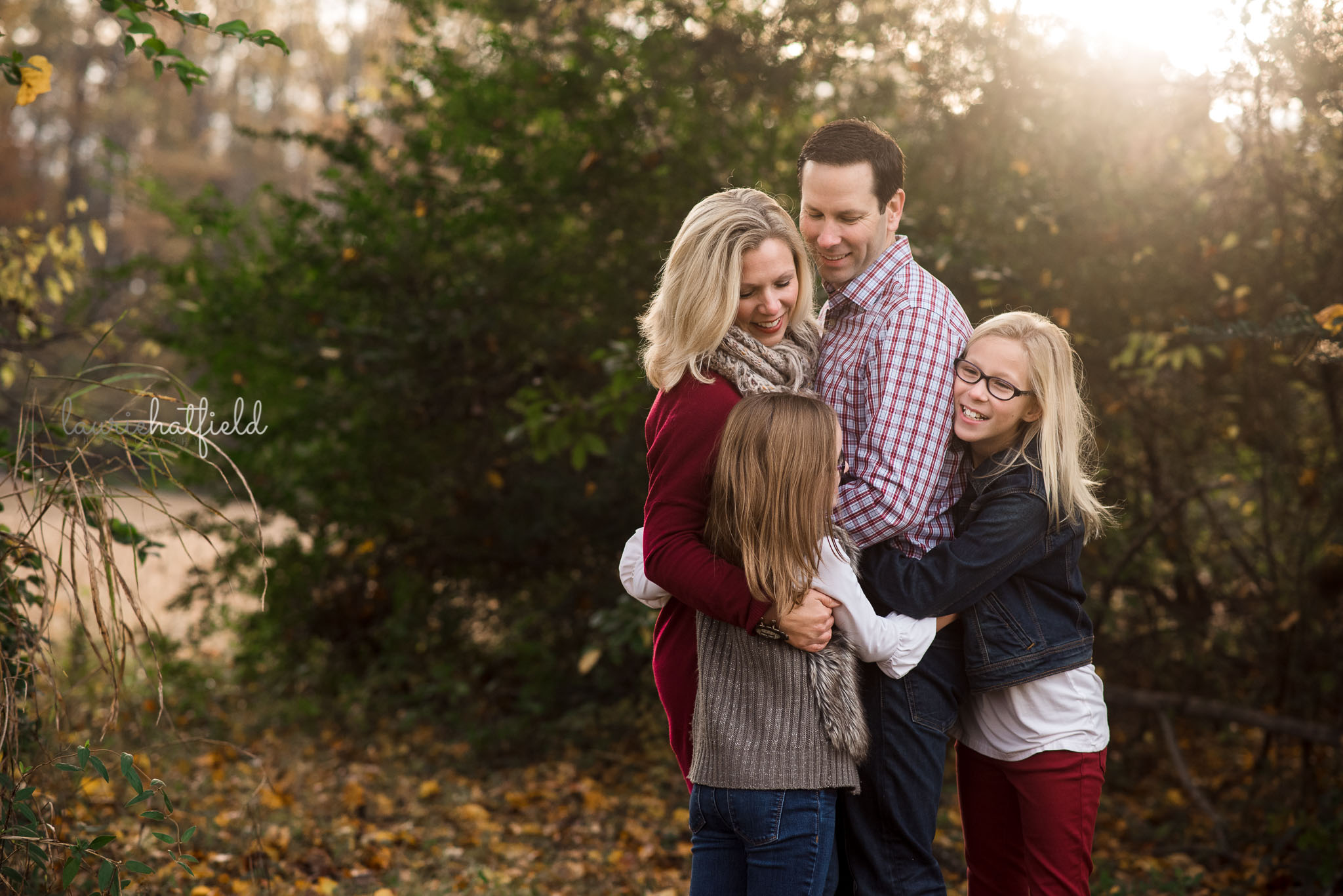 family of four hugging | Mobile AL photographer