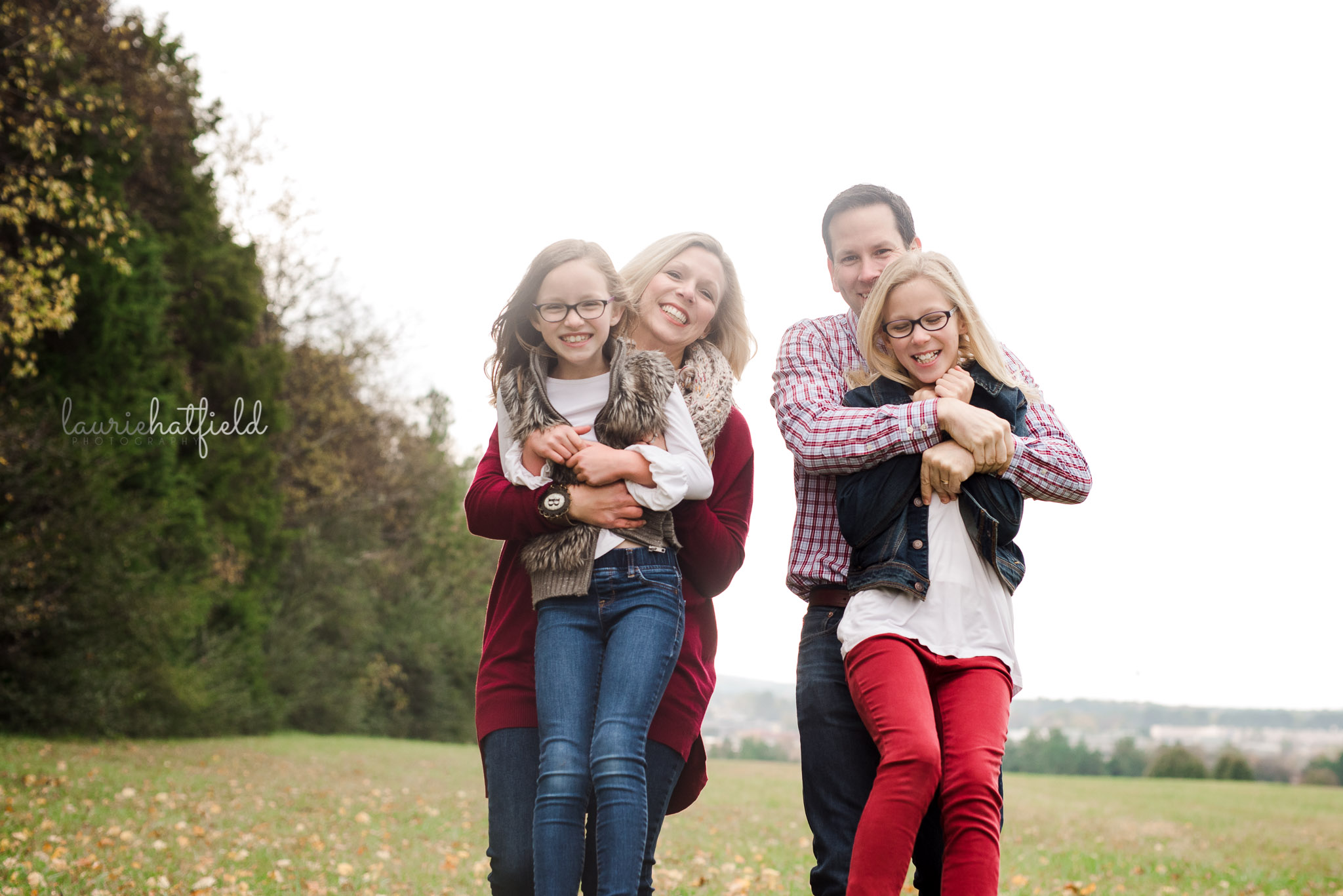 mom and dad carrying daughters | Mobile AL photo session