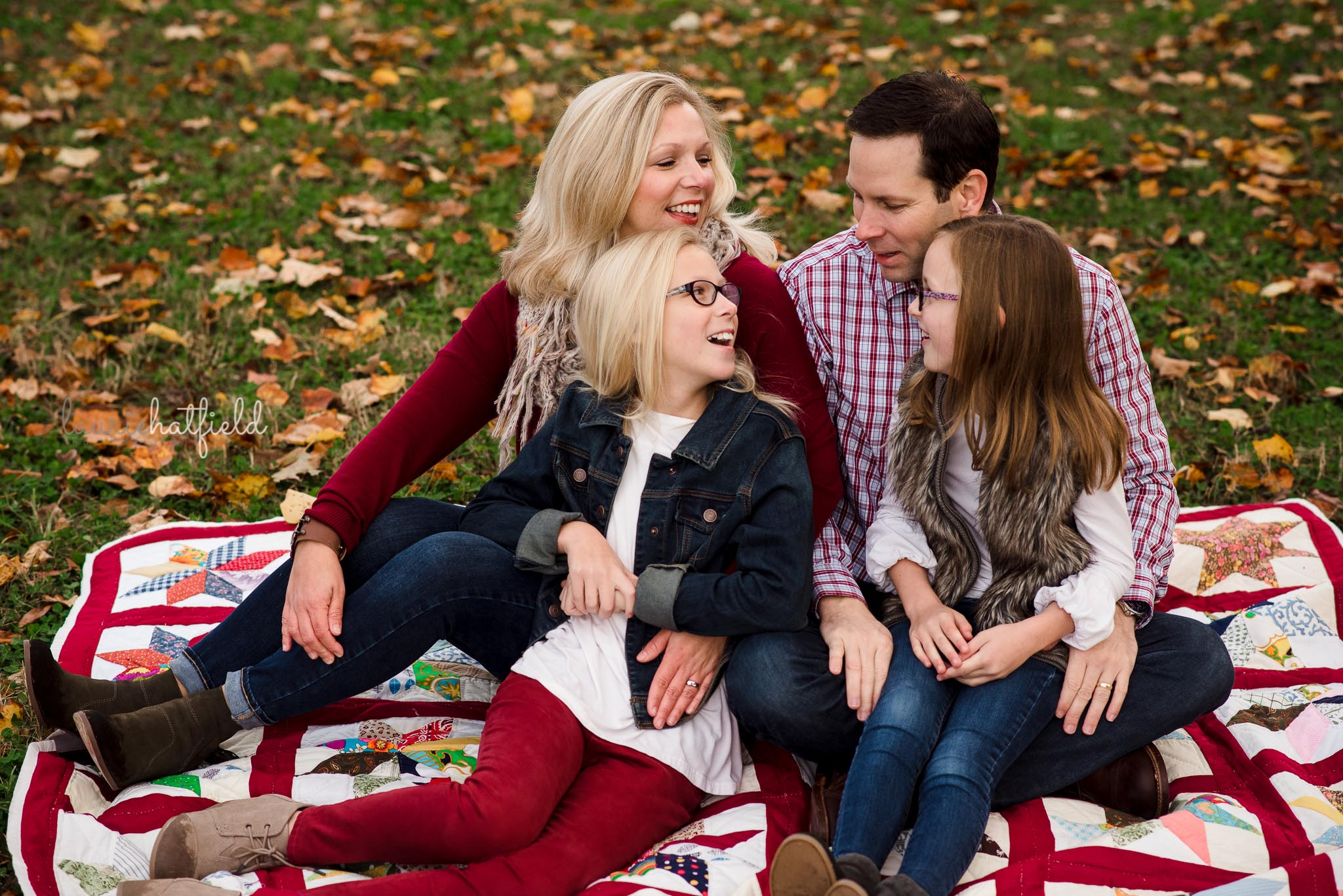 family of four sitting on blanket | Mobile AL photography