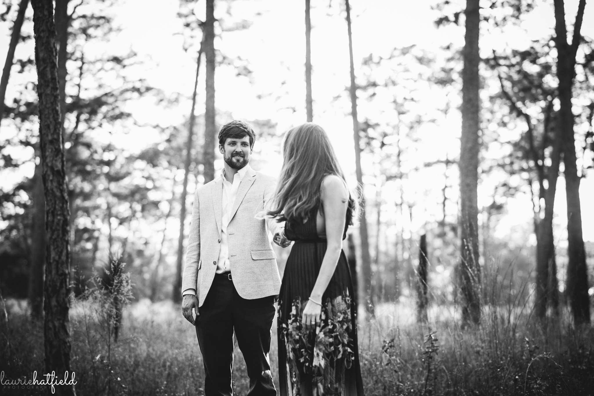 couple walking through the woods | Mobile AL family photographer