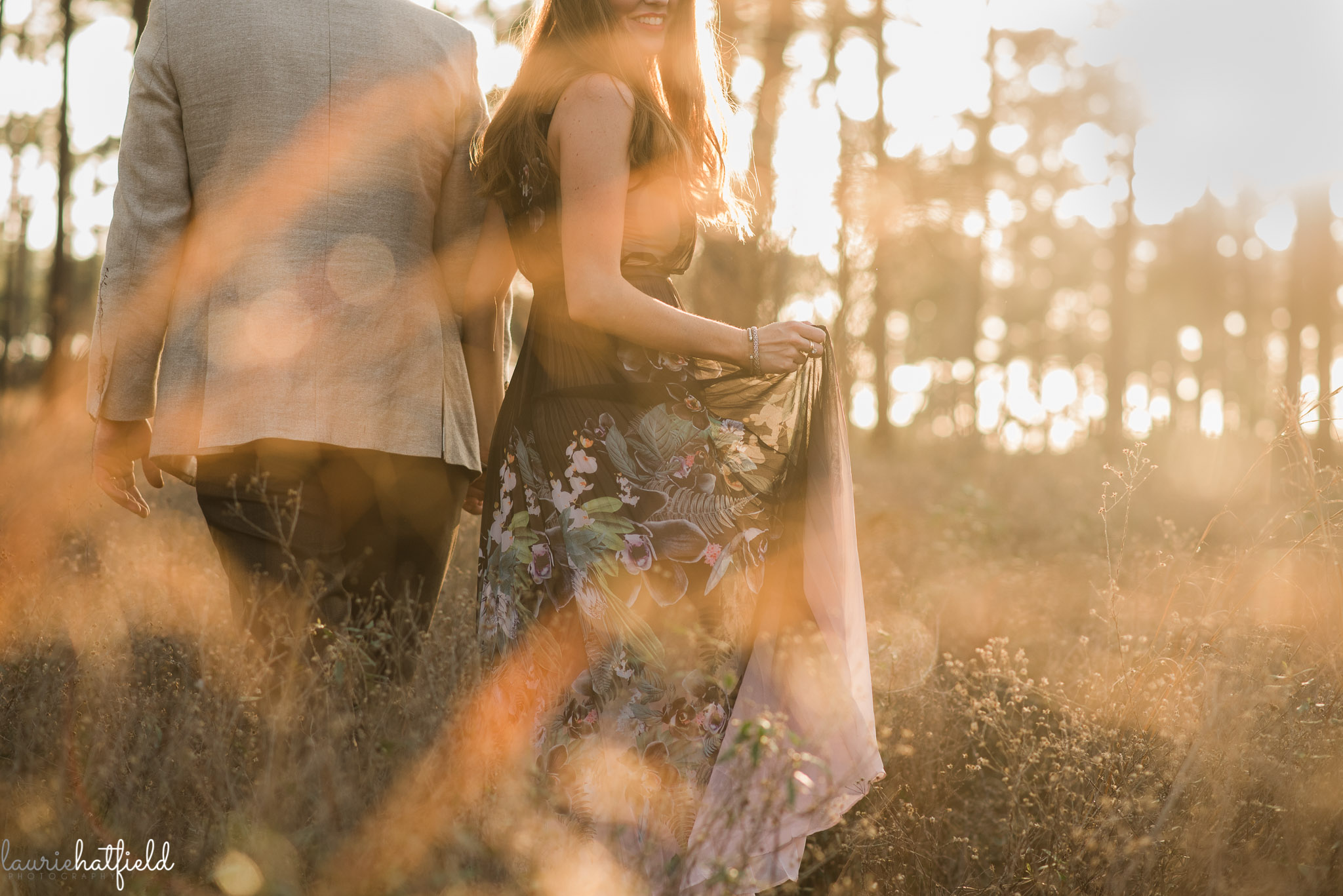 pregnant woman walking through field | Mobile AL maternity photographer