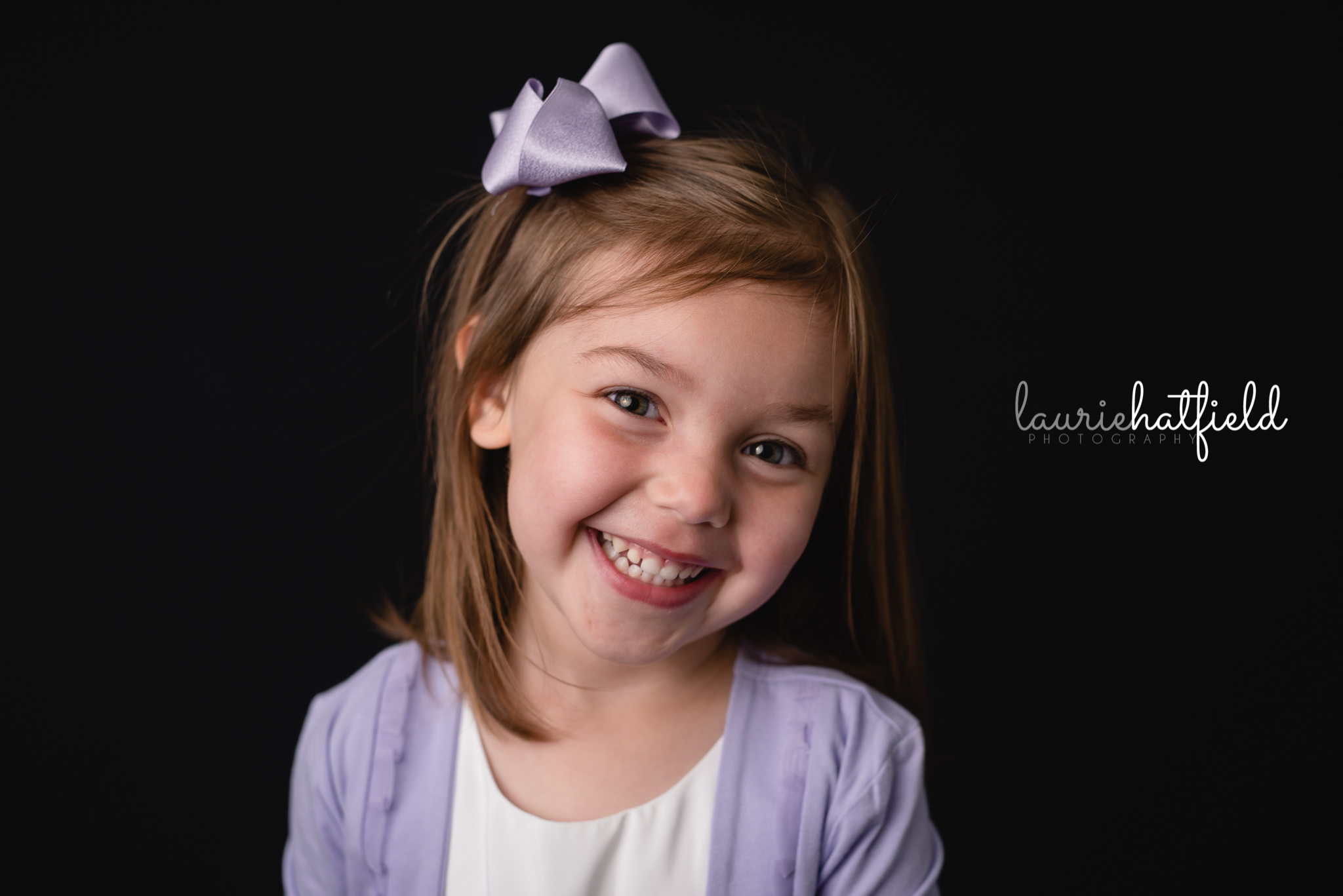 little girl with purple bow | Mobile AL school photographer