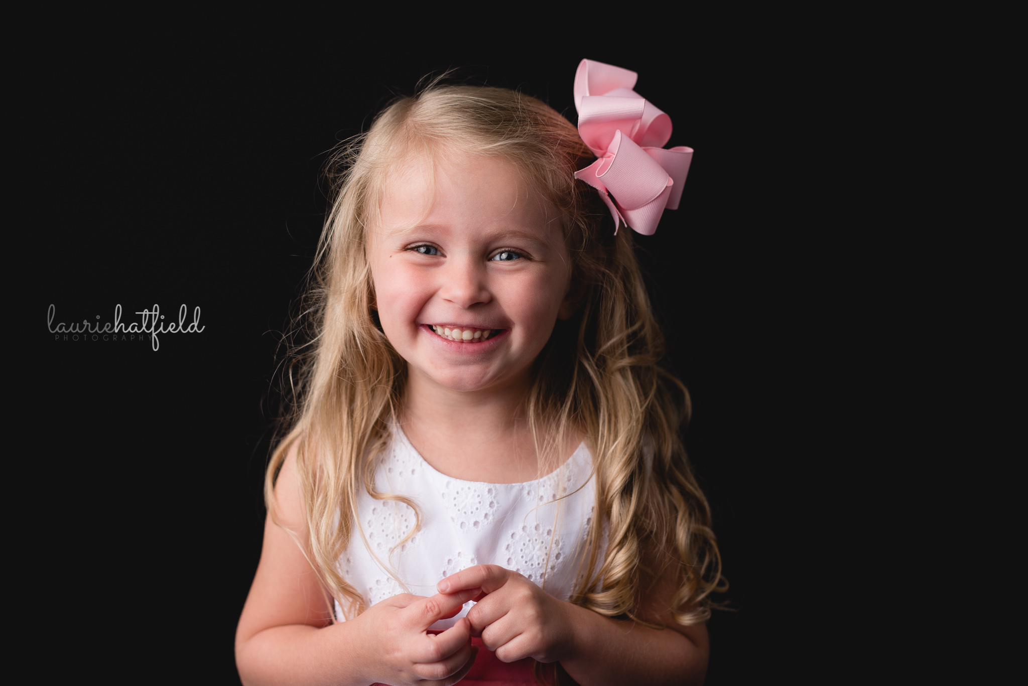 little girl with white dress and pink bow | Mobile AL school portraits