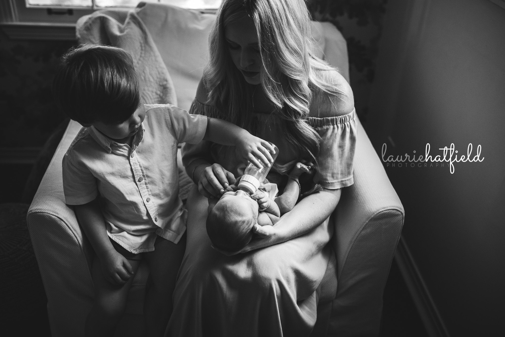 big brother helping feed baby | Mobile AL newborn photographer