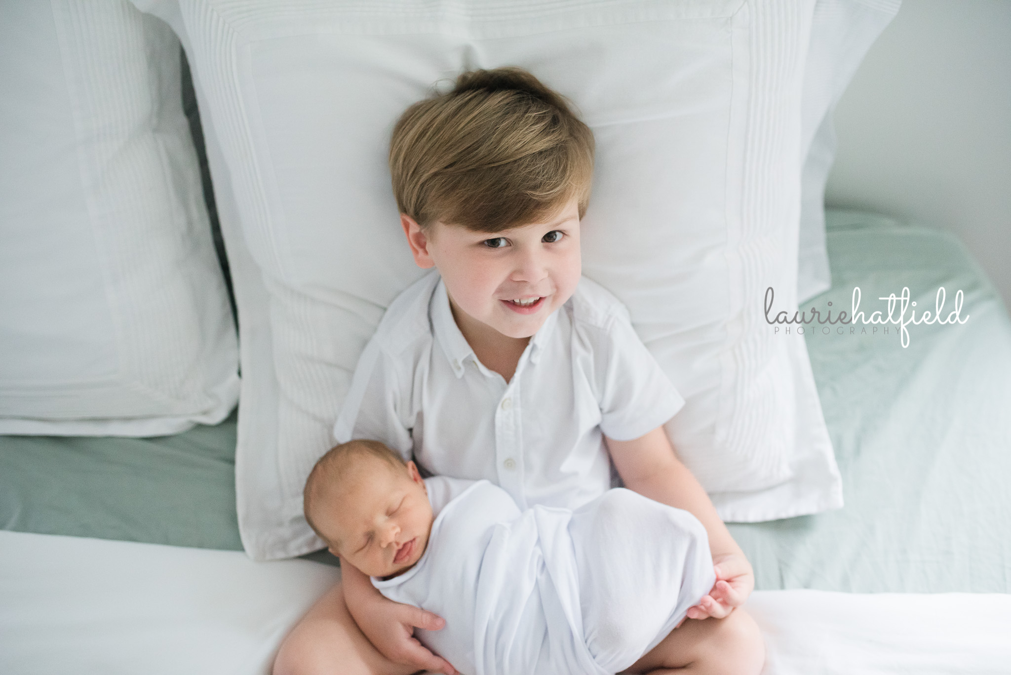 brother holding new baby sister | Mobile AL newborn pictures
