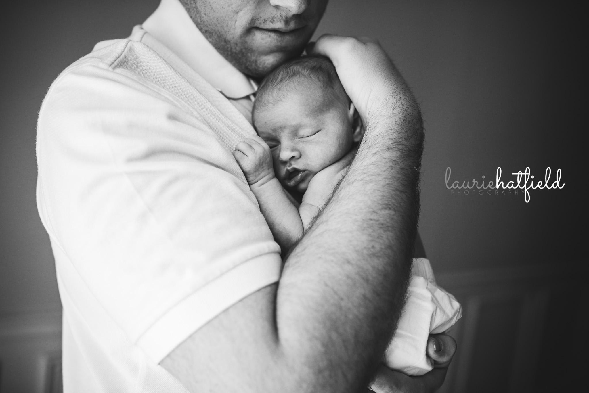 dad holding baby girl | Daphne AL newborn photographer
