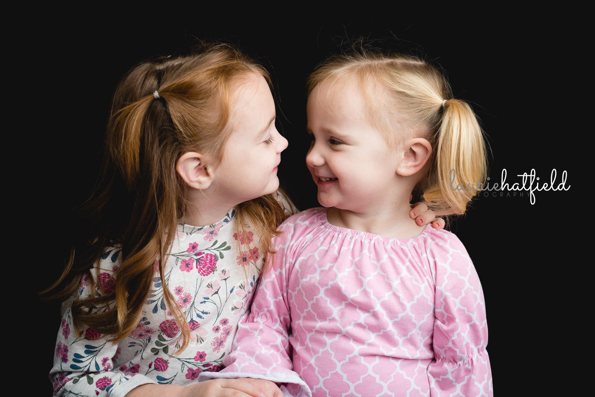 sisters looking at each other | Huntsville AL preschool portraits