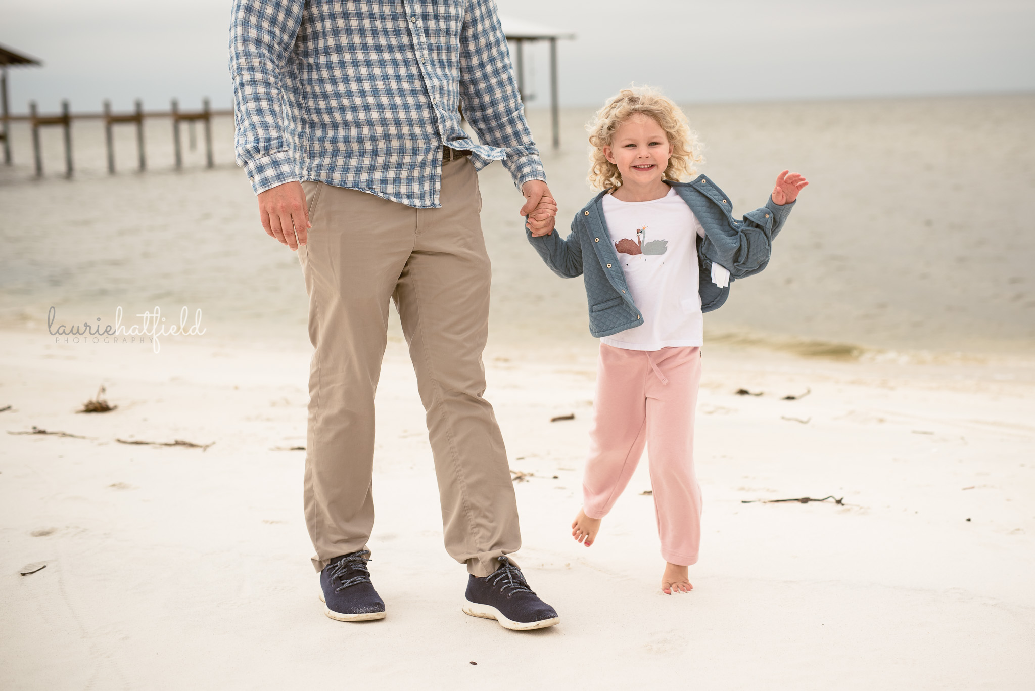 little girl walking with dad on the beach | Decatur AL family photographer