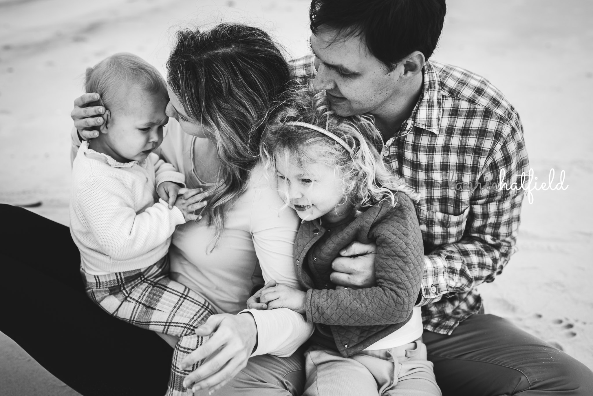 family snuggling on the beach | Huntsville Alabama photo session