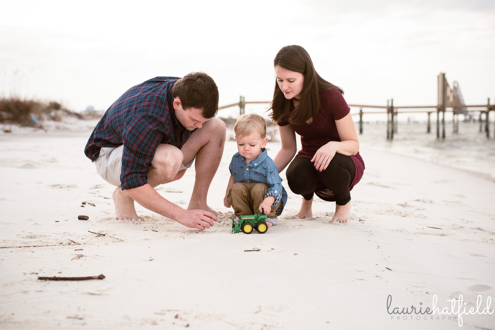 mom, and, and boy playing trucks on the beach | Huntsville Al family photographer