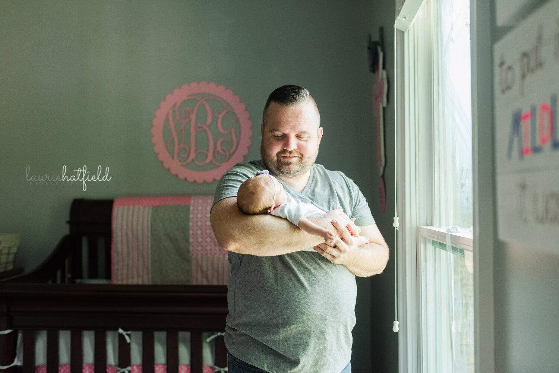 dad holding baby girl   Huntsville Alabama newborn photo session