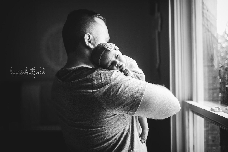 baby girl on dad's shoulder   Hartselle AL newborn photographer