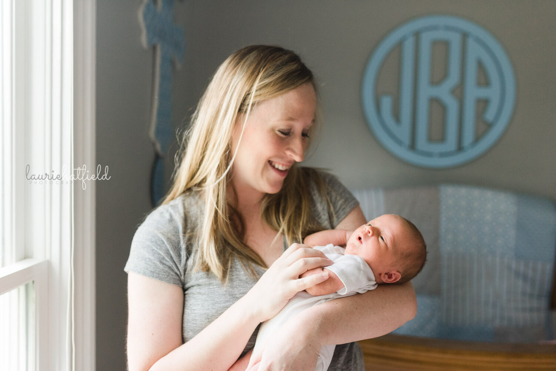 mom holding baby boy   Huntsville AL newborn photographer