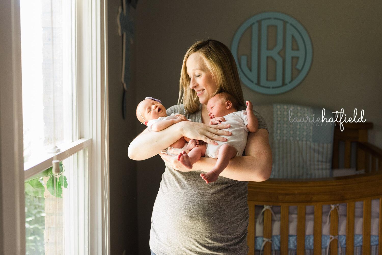 mom holding twins   Huntsville AL newborn photographer
