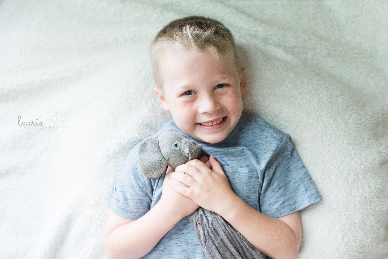 5-year-old brother in gray shirt   Huntsville AL newborn photographer