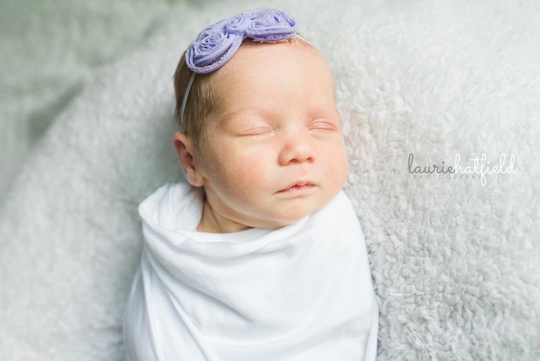 baby girl in purple headband   Huntsville AL newborn pictures