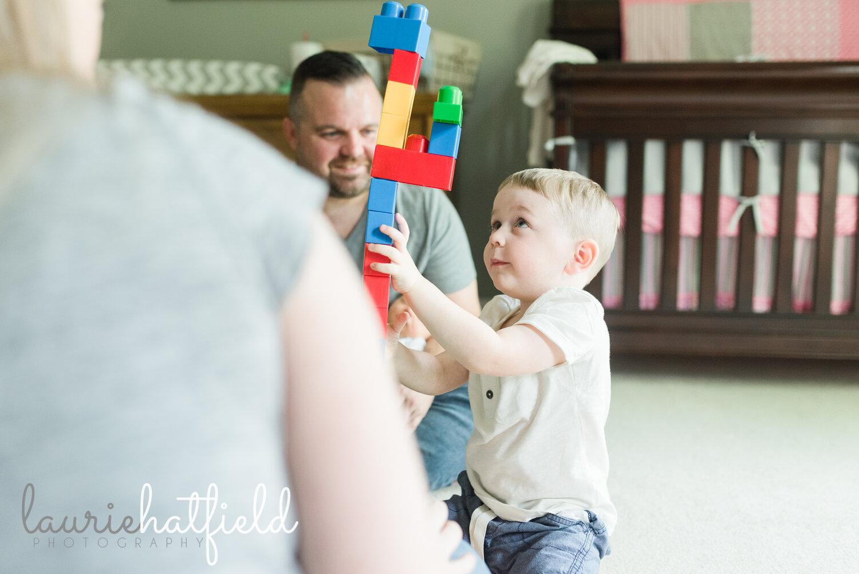 boy playing blocks with parents   Huntsville AL newborn pictures