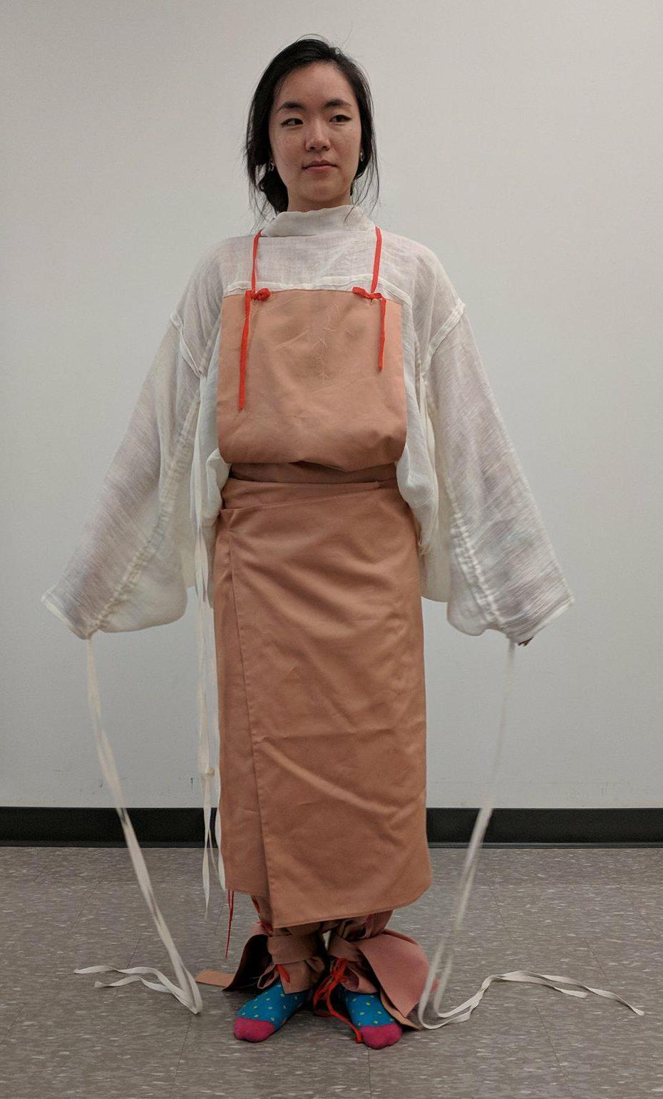 With Apron Tied to Front