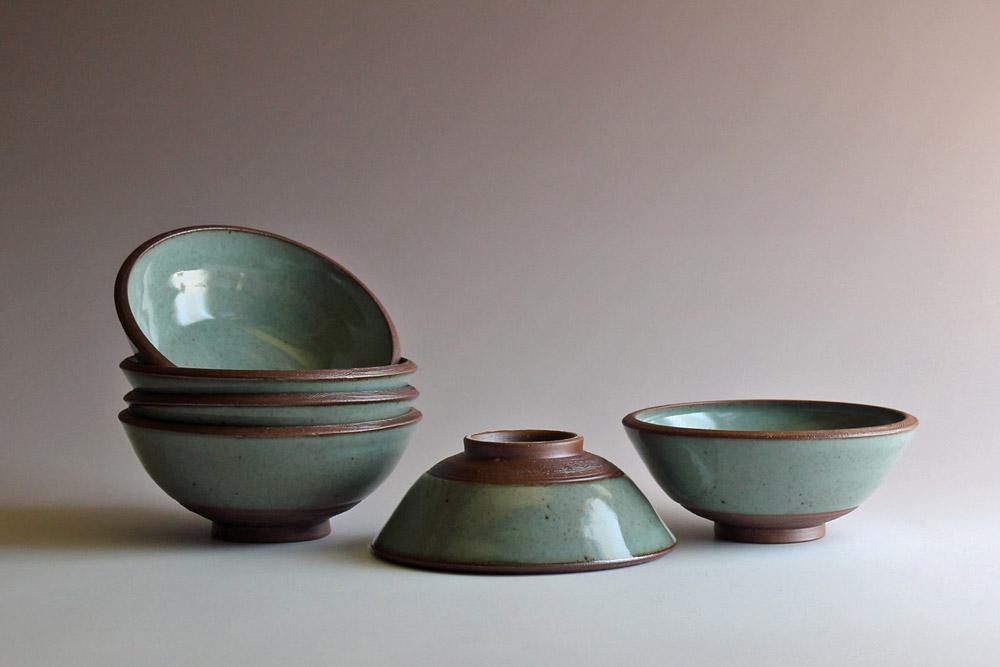 Four bowls with celadon glaze