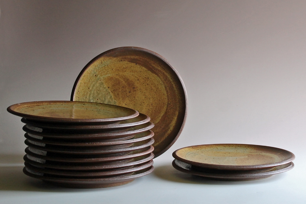 Dinner plates with matte yellow glaze