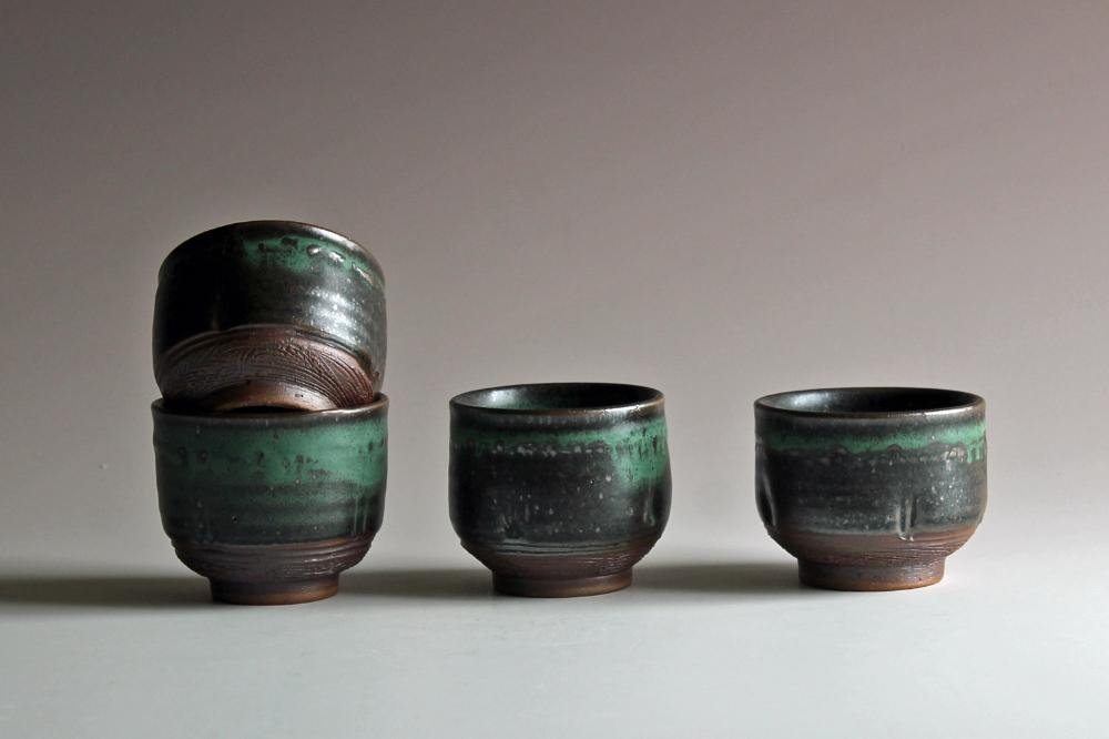 Little cups with matte green glaze