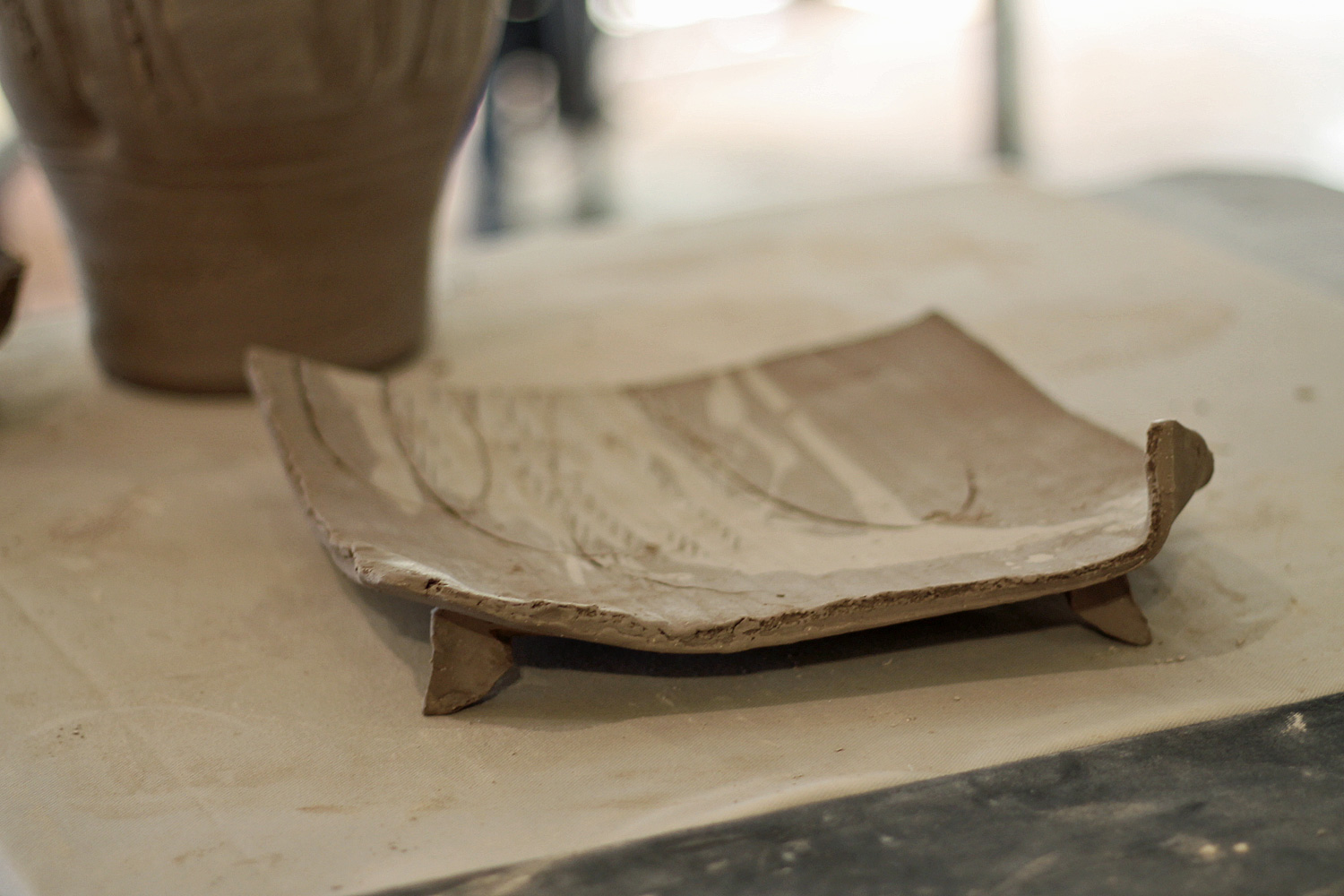 slab-built stoneware plate with feet
