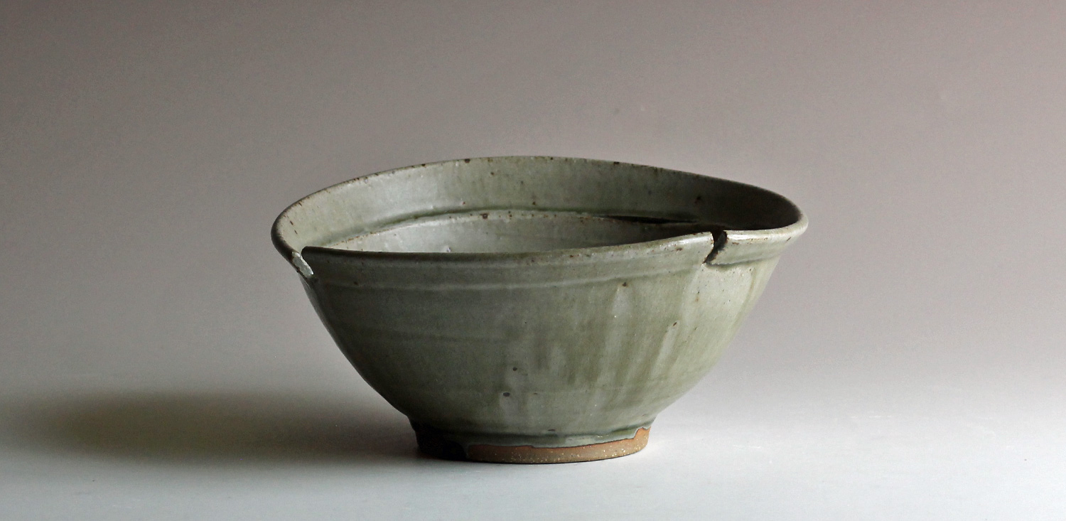 thrown and altered stoneware bowl with ash glaze