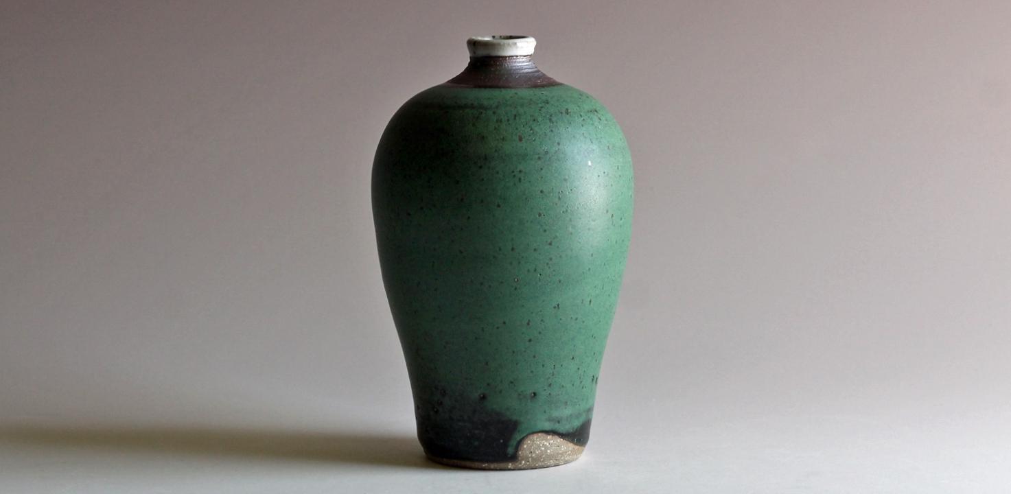 stoneware bottle with green glaze